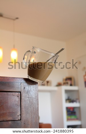 falling coffee cup at home - stock photo