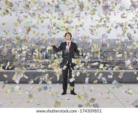 Falling down euros and businessman 3 - stock photo
