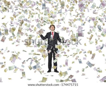Falling down euros and businessman - stock photo
