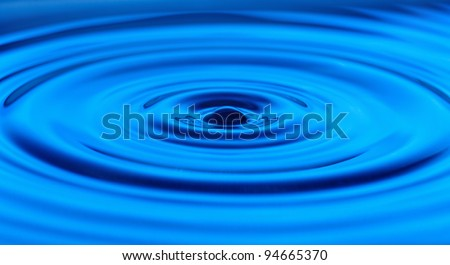 Falling drops of water. Splash effect after collision a falling drop with water surface. - stock photo