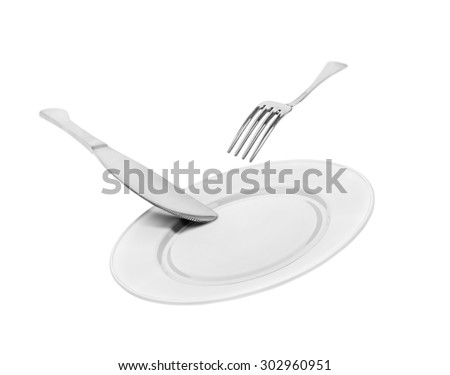 falling empty white plate, knife and fork isolated on white background - stock photo