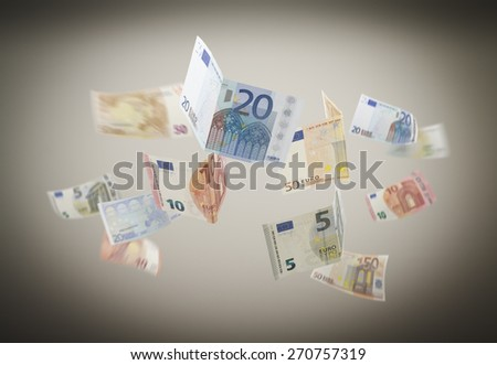 Falling Euro on the grey background. - stock photo