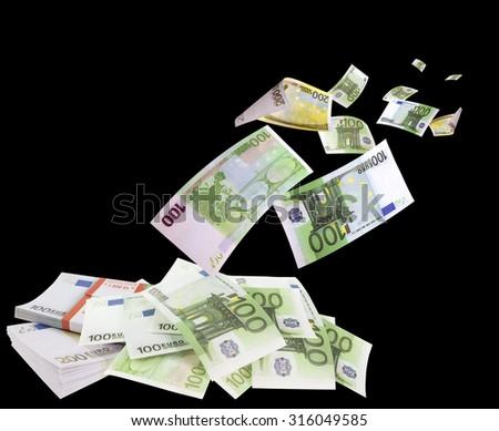 Falling euros isolated on black background - stock photo