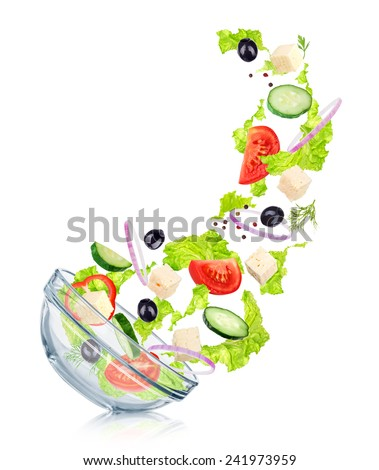 Falling Greek salad in a glass salad bowl with reflection. Concept slim figure - stock photo