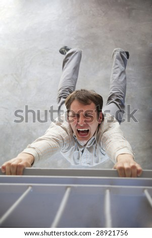 falling man trying to save himself - stock photo