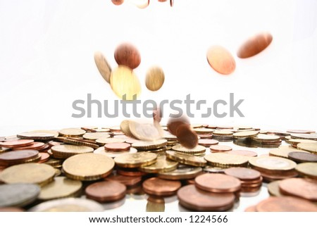 falling money, the falling coins are motion-blurred! lots of coins symbolize money rain - stock photo