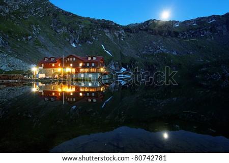 Falling night over Balea Lake, Transylvanian Alps, Romania - stock photo