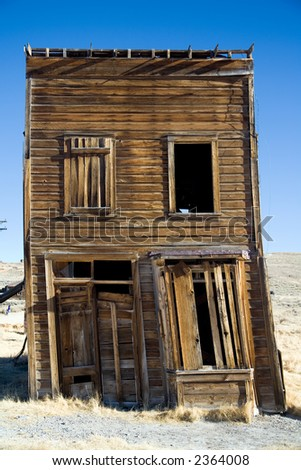 Falling old wooden house in Bodie ghost town in California. - stock photo