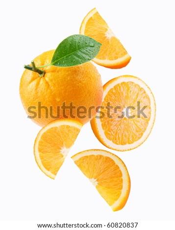 Falling orange and orange slices. Isolated on a white background. - stock photo