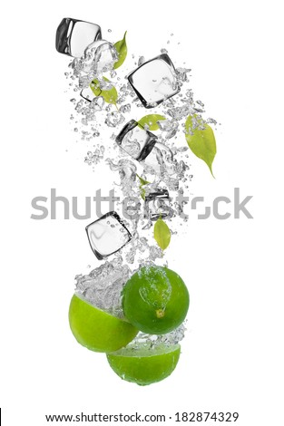 Falling pieces of limes in water splash and ice cubes, isolated on white background - stock photo