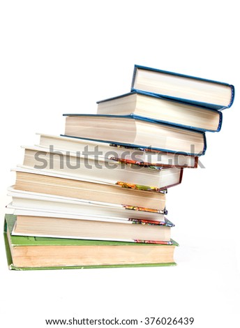 Falling pile of books it is isolated on a white background