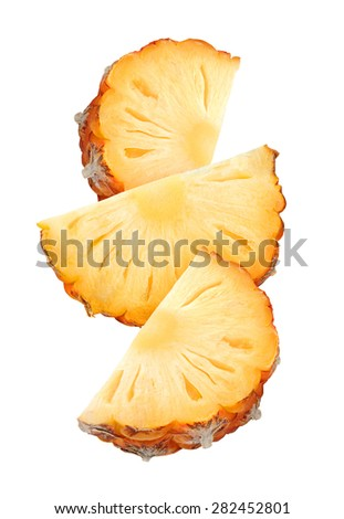 Falling pineapple slices isolated on white background, with clipping path - stock photo