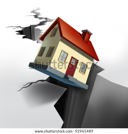 Falling real estate prices and housing market decline with earthquake cracked  floor showing a huge hole in the ground and a model home that is descending  and sinking into debt and foreclosure. - stock photo