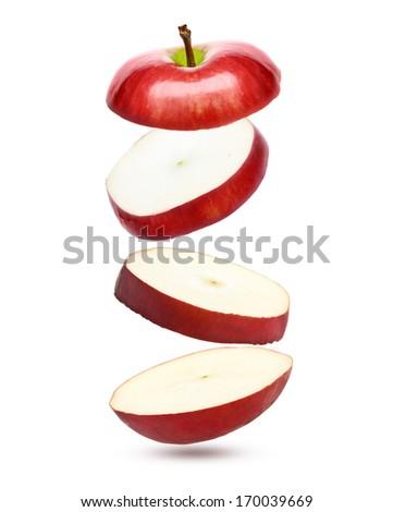 Falling red apple isolated on white background.