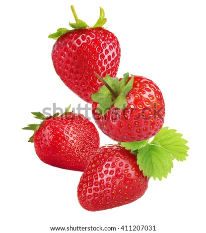 Falling ripe strawberries isolated on white - stock photo