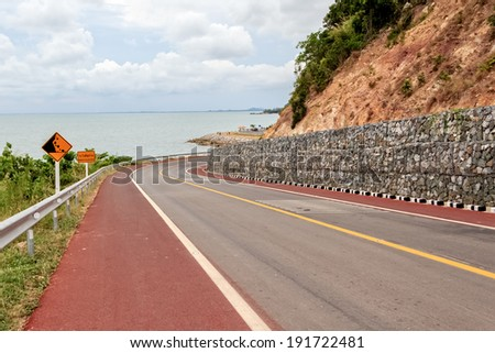 Falling Rocks Protection of Winding Road  - stock photo
