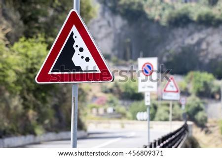 Falling Rocks Road Sign - stock photo