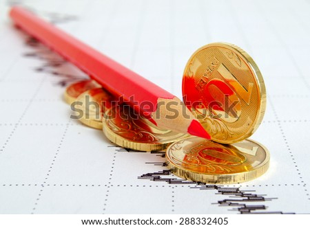 Falling ruble, still life with financial charts and coins. - stock photo