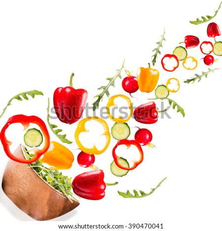 Falling salad in a wooden salad bowl. Vegetable isolated on white backgroud. Fresh pepper - stock photo