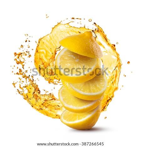 Falling slices of lemon against juice splash isolated on white background - stock photo