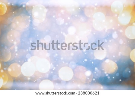 Falling Snow With Yellow Bokeh and Stars On The Blue Background - stock photo