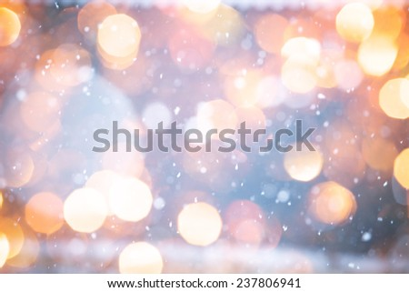 Falling Snow With Yellow Bokeh On The Blue Background - stock photo