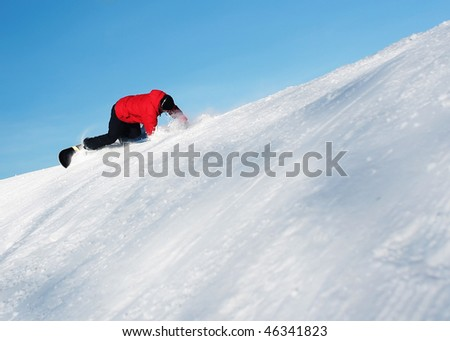 Falling snowboarder under blue clear sky