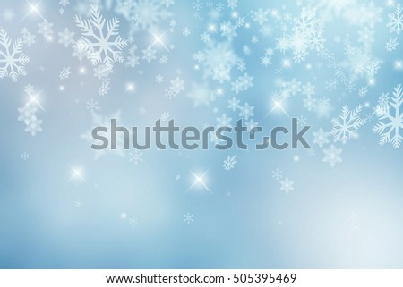 Falling snowflakes and sparkles against a light blue background