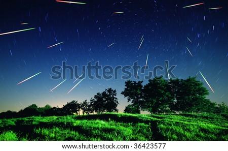 Falling stars at night - stock photo
