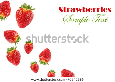 Falling strawberries, isolated on white - stock photo