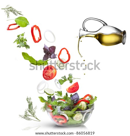 Falling vegetables for salad and oil isolated on white - stock photo