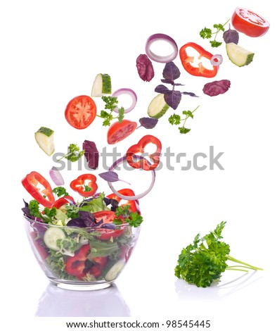 Falling vegetables to bacon isolated on a white background. - stock photo