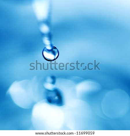 Falling water drop (shallow DoF) - stock photo