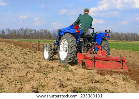 Fallowing of a spring field  - stock photo