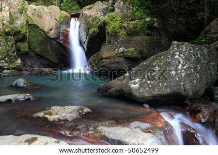 Falls and pool below La Mina Falls in the El Yunque rainforest in the Caribbean National Forest, Puerto Rico - stock photo