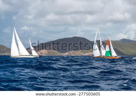 Falmouth, Antigua.  19th May 2015: Cuilaun and Saphaedra, racing in the Antigua Classic Yacht  Regatta 2015 - stock photo