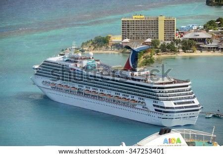 FALMOUTH, JAMAICA - DEC 29: Carnival Cruise ship Victory anchor offshore on Dec. 29, 2014 in Ocho Rios, Jamaica. - stock photo