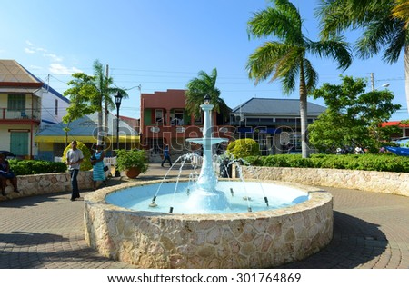 FALMOUTH, JAMAICA - DEC 29: Falmouth Water Square is the busy hub of Falmouth on Dec. 29, 2014 in Falmouth, Jamaica. Falmouth boasted running water before New York  City in 1798.  - stock photo