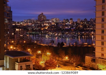 False Creek Morning Twilight. Looking towards the Fairview Slopes neighborhood of Vancouver on the south side of False Creek from Yaletown in the early morning. Vancouver, British Columbia, Canada. - stock photo