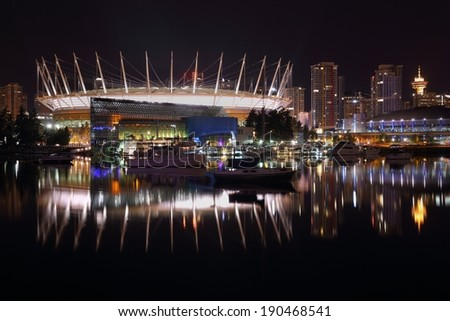 False Creek Night, Vancouver. Vancouver False Creek view of the city skyline and the sports stadiums at night. British Columbia, Canada.  - stock photo