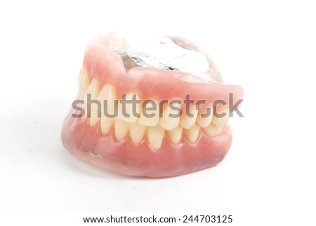 false teeth prosthetic isolated on white background
