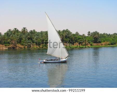 Faluca boat sailing in Nile river, Egypt - stock photo