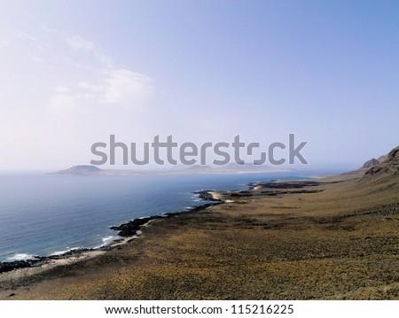 Famara Cliffs and Graciosa Island, Lanzarote, Canary Islands, Spain - stock photo