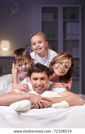 Families in bed at night at home - stock photo