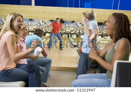 Families on trip to bowling alley - stock photo
