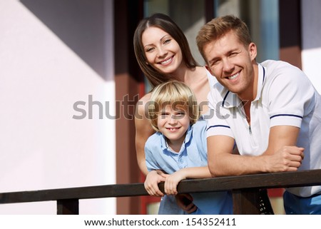 Families with a child by the house - stock photo