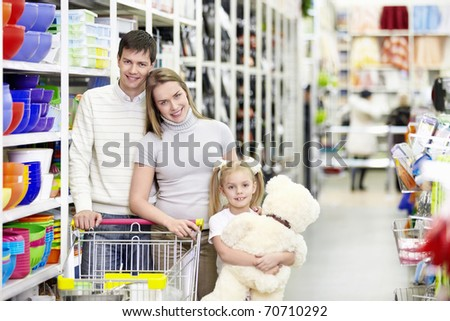 Families with a child makes a purchase in a store - stock photo