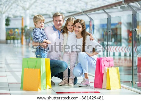Families with a children in a store - stock photo