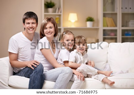 Families with children in the evening at home - stock photo