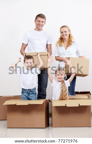 Families with children jumped out of cardboard boxes - stock photo